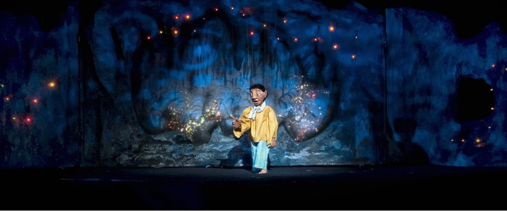 Aladdin is in the cave with the magic lamp