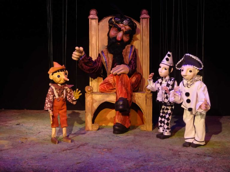 With the puppet theatre boss